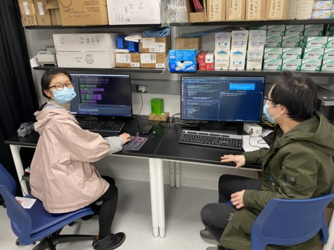 Jiacheng and Yanyan at work in the lab